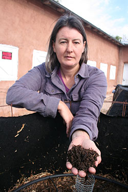 Amy Larsen Holding a Hand of Finished Johnson-Su Bioreactor Compost