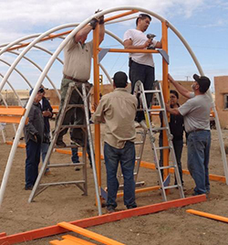 Students a Building Hoop House